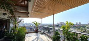 פרגולה למרפסת מאלומיניום דמוי עץ